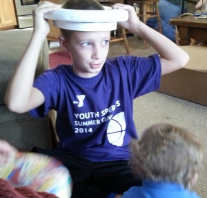 Jameson, in a toddler toilet seat crown--at Uncle Jade's birthday party.