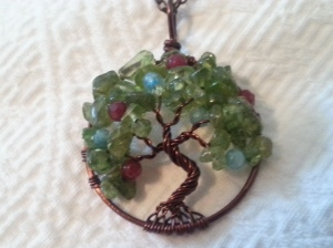 65th Birthday gift from Dave. A peridot and copper tree, my birthstone, with ruby (Jade's) and aquamarine (John's).