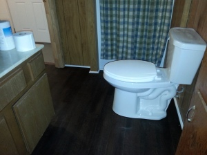 "New floor--and new toilet (which, in the South, is a ""commode"")"
